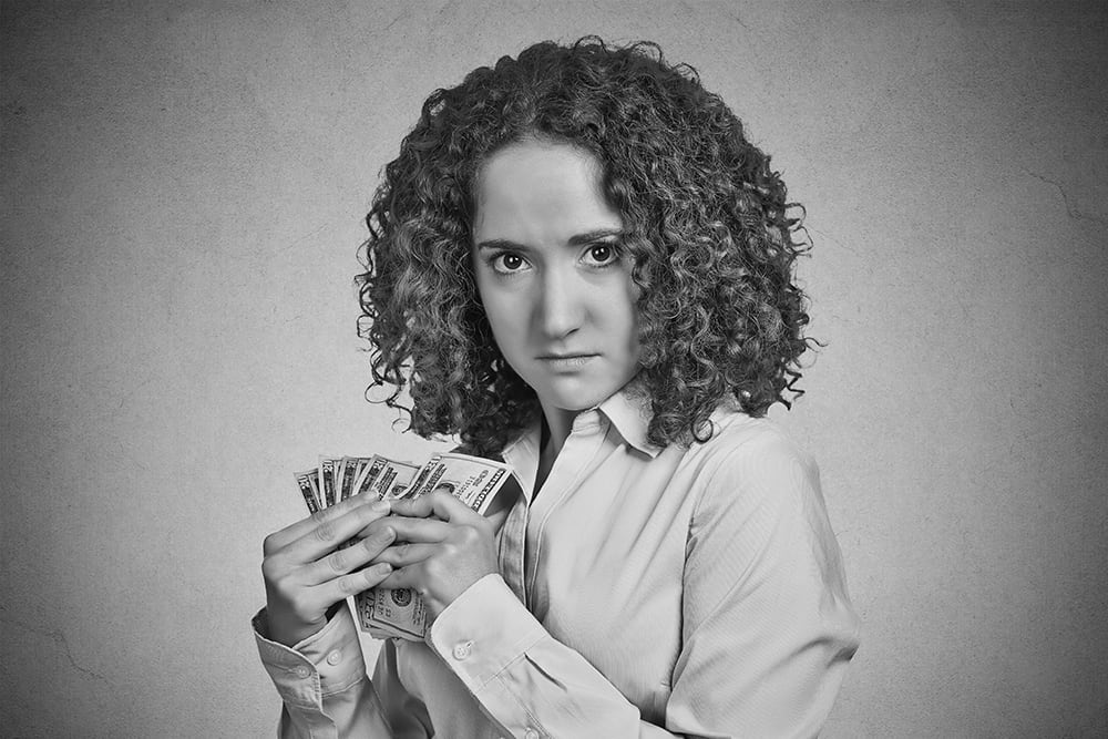 Business woman protecting cash